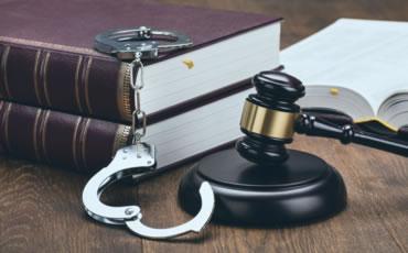 Prison Law Books and Cuffs
